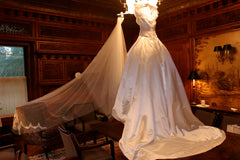 Reem Acra '9817' size 2 used wedding dress side view on hanger