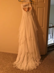 Essence of Australia '1799' size 4 used wedding dress back view on hanger