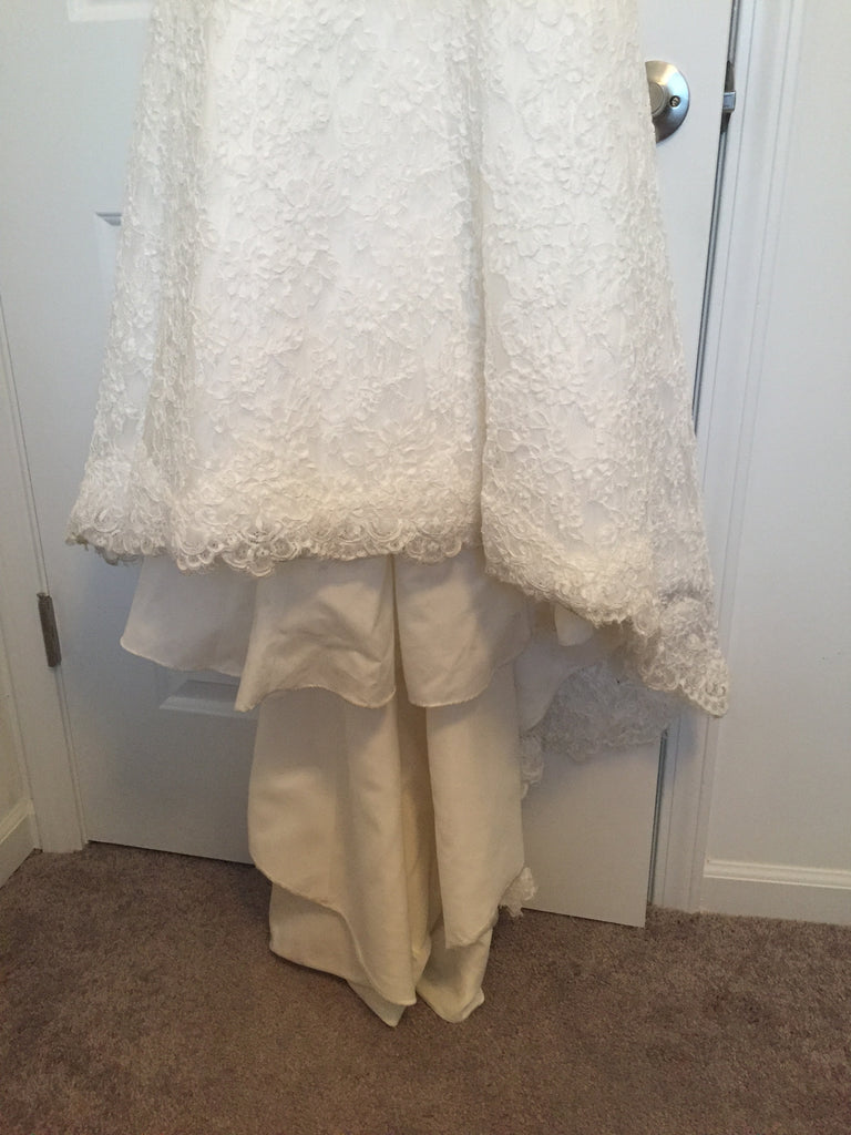 Demetrios '1443' size 4 used wedding dress view of hem