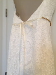 Demetrios '1443' size 4 used wedding dress back view on hanger