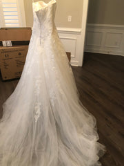 Pronovias 'Barroco' size 8 used wedding dress back view on hanger