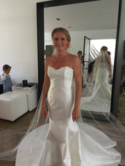Romona Keveza 'Legends' size 8 used wedding dress front view on bride