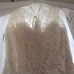 Maggie Sottero 'Melanie' size 8 new wedding dress front view on hanger