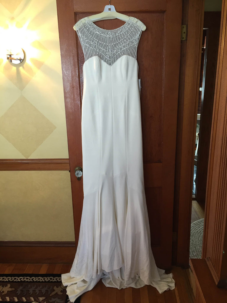 Nicole Miller 'Lily' size 6 new wedding dress front view on hanger