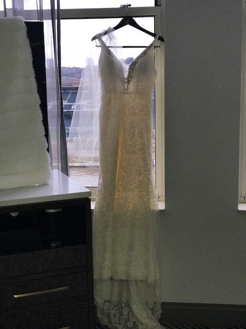 Eugenia Couture 'Timeless' size 8 used wedding dress front view on hanger