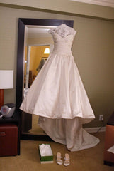 Custom 'Michael of Boston' size 0 used wedding dress front view on hanger