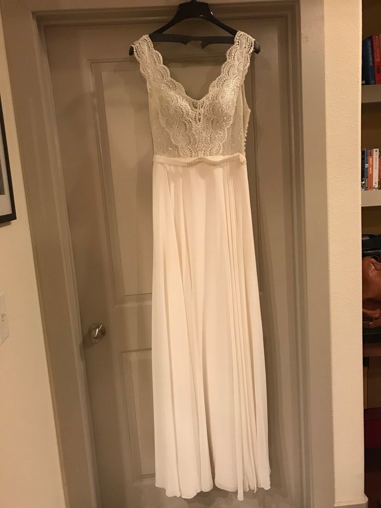 Flora Bridal 'Madeline' size 4 sample wedding dress front view on hanger