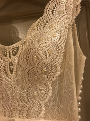 Flora Bridal 'Madeline' size 4 sample wedding dress front view close up on hanger