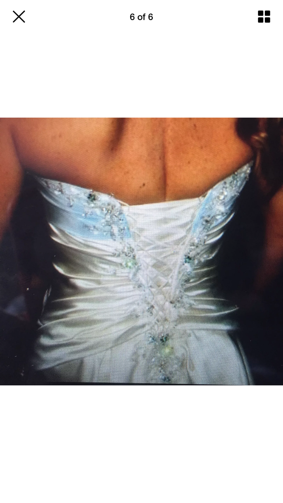 Custom 'Strapless' size 6 used wedding dress back view on bride
