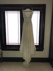 Pnina Tornai '4114' size 6 used wedding dress back view on hangerner
