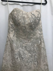 David's Bridal 'Champagne Strapless' size 4 used wedding dress front view on hanger