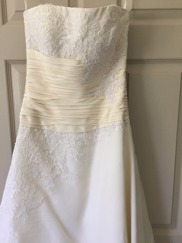 Christos '73' size 4 used wedding dress front view on hanger