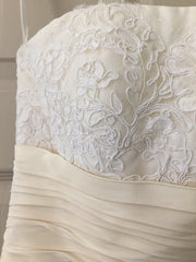 Christos '73' size 4 used wedding dress front view of bust