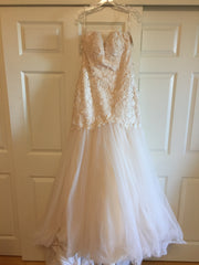 Martina Liana 'Mermaid' size 8 sample wedding dress front view on hanger