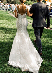 Maggie Sottero 'Jackie' size 0 used wedding dress back view on bride