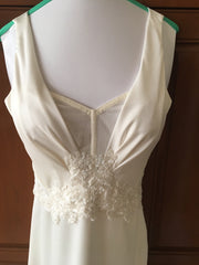 Kenneth Pool 'Faith' size 4 used wedding dress front view on mannequin