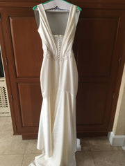 Kenneth Pool 'Faith' size 4 used wedding dress back view on hanger