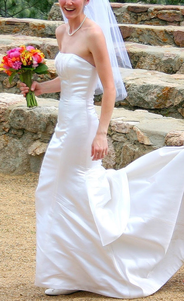 Custom 'Strapless' size 2 used wedding dress side view on bride