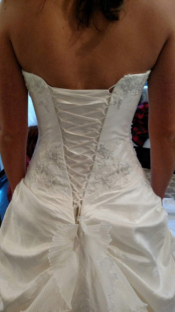 Sottero and Midgley 'A Line' size 6 used wedding dress back view on bride