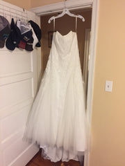 David's Bridal 'Strapless' size 14 new wedding dress front view on hanger