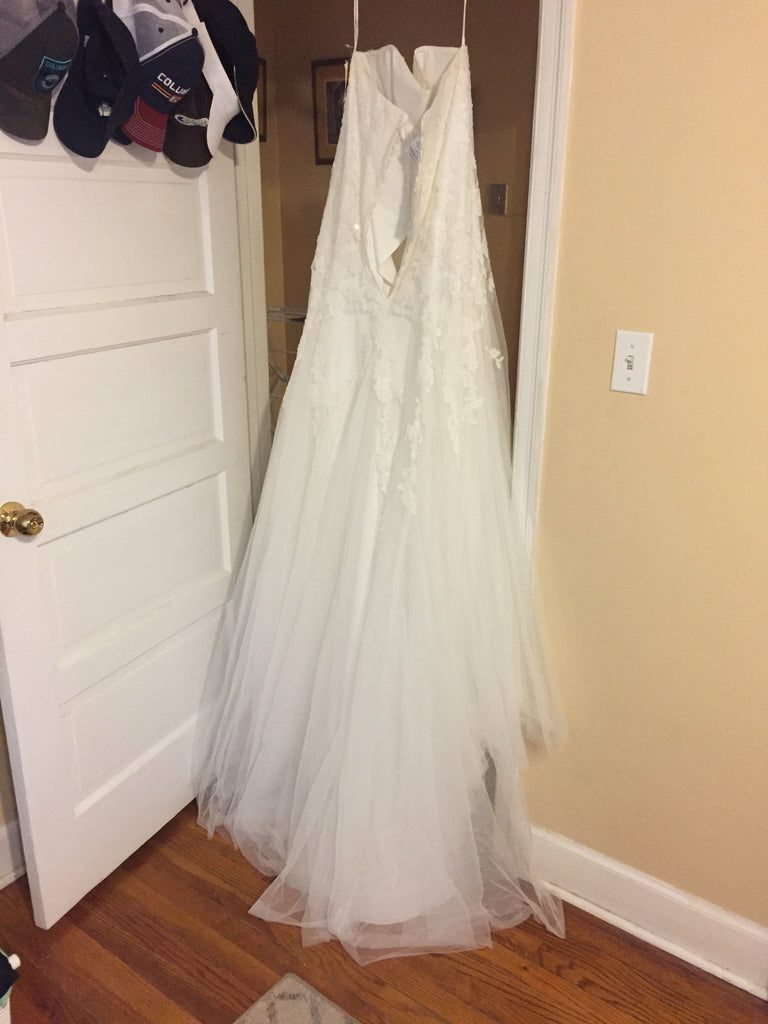 David's Bridal 'Strapless' size 14 new wedding dress back view on hanger
