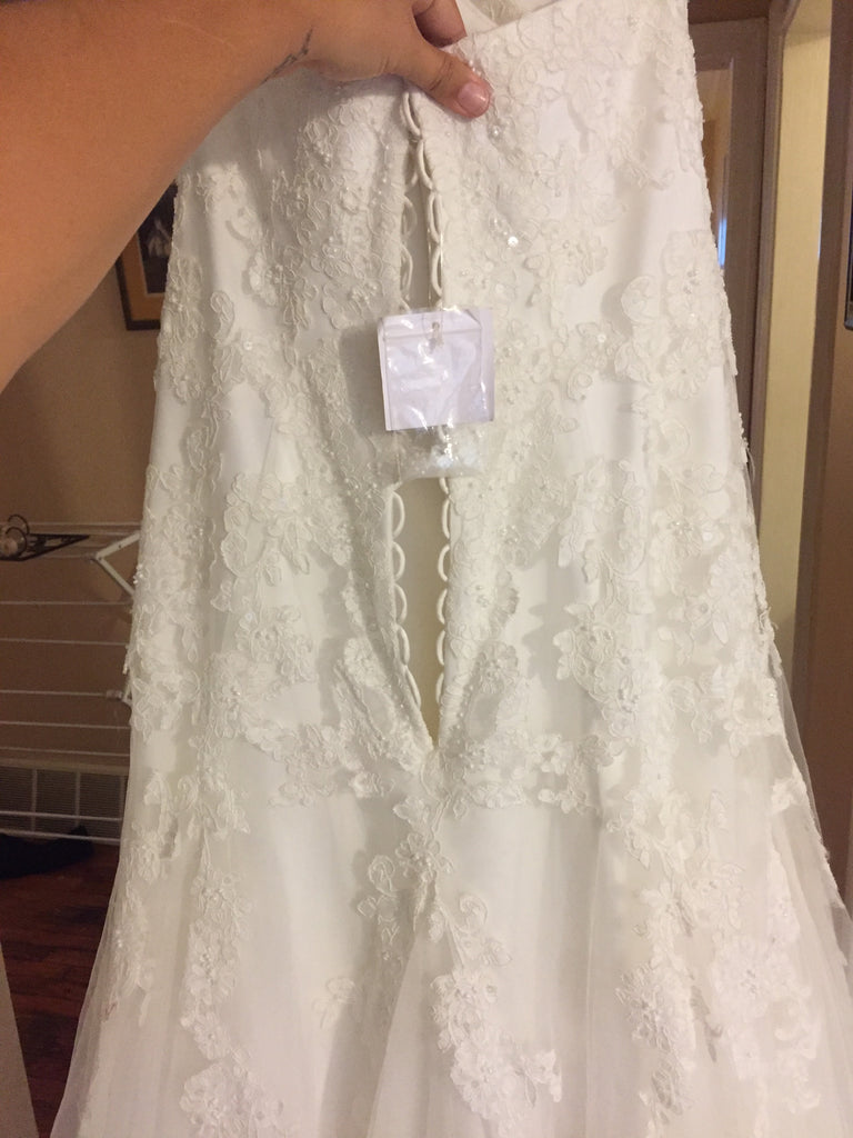 David's Bridal 'Strapless' size 14 new wedding dress back view close up on hanger