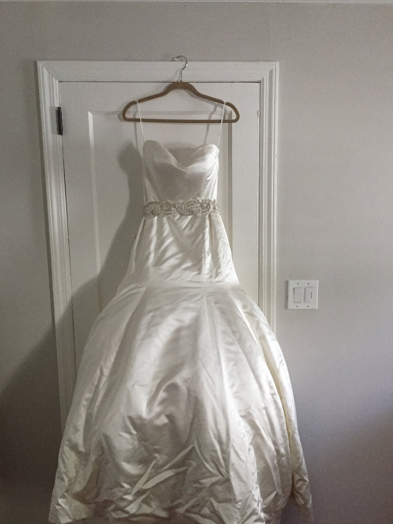 Casablanca '079' size 8 used wedding dress front view on hanger