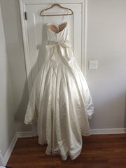 Casablanca '079' size 8 used wedding dress back view on hanger