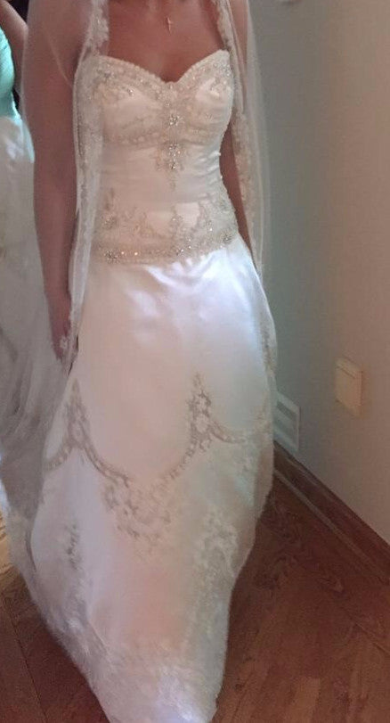 Amalia Carrara '104 cp-11' size 12 used wedding dress front view on bride