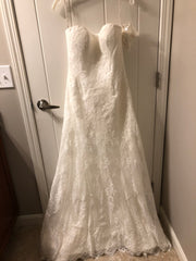 Maggie Sottero 'Mariah' size 8 new wedding dress front view on hanger