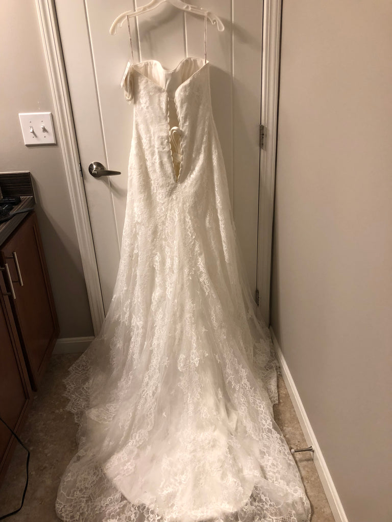 Maggie Sottero 'Mariah' size 8 new wedding dress back view on hanger