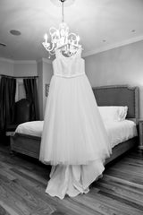 David's Bridal 'Lace Illusion' size 14 used wedding dress front view on hanger