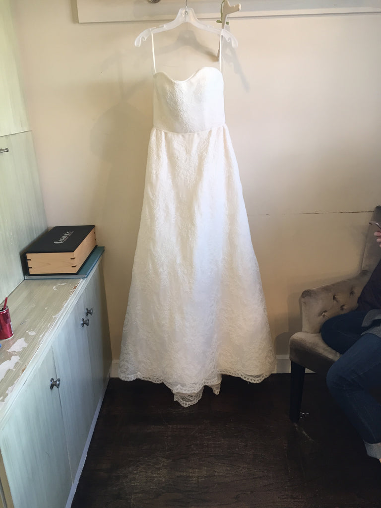 Judd Waddell 'Dusty' size 6 sample wedding dress front view on hanger