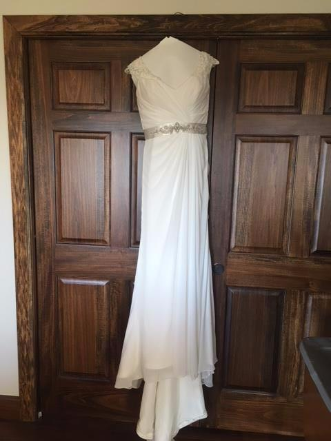Maggie Sottero 'Crystal Capped Sleeves' size 8 sample wedding dress front view on hanger