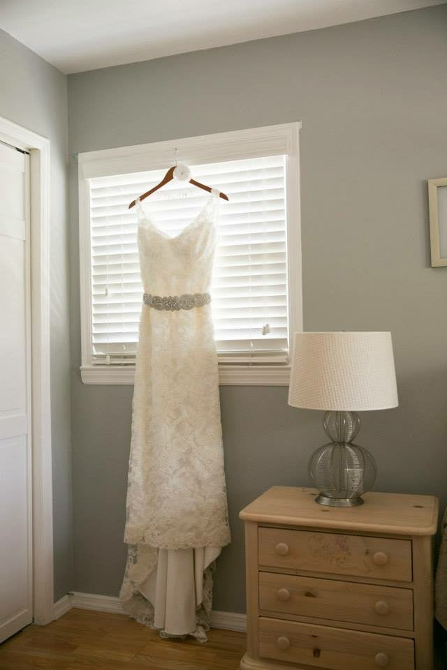Jim Hjelm '8958' size 14 used wedding dress front view on hanger