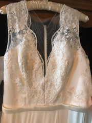 Theia 'Alicia' size 12 sample wedding dress front view on hanger