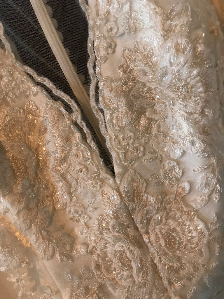 Theia 'Alicia' size 12 sample wedding dress front view close up on hanger