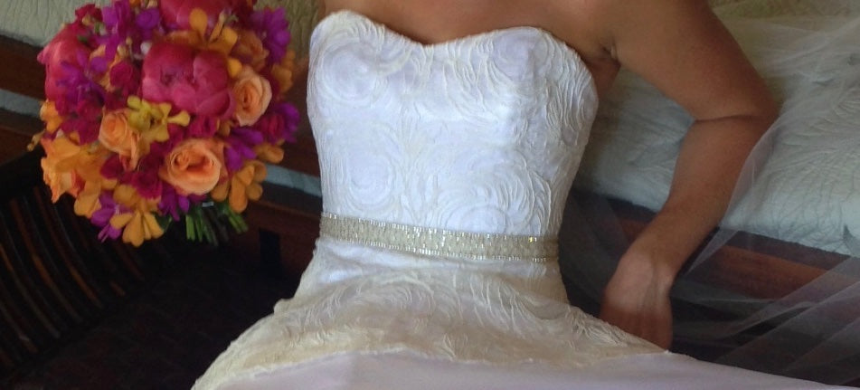 Ulla Maija 'Sacha' size 6 used wedding dress front view close up on bride
