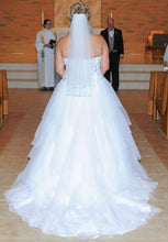 Load image into Gallery viewer, Jewel 'Strapless Tiered Tulle' size 14 used wedding dress back view on bride