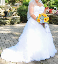 Load image into Gallery viewer, Jewel 'Strapless Tiered Tulle' size 14 used wedding dress front view on bride