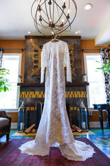 Pronovias 'Elvira' size 4 used wedding dress front view on hanger