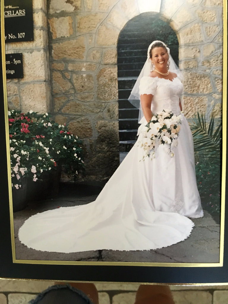Custom 'Satin' size 16 used wedding dress front view on bride standing