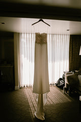 Unbridaled by Dan Jones 'Embroidered Corset Gown' size 8 used wedding dress front view on hanger