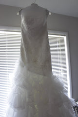 Galina '560' size 4 used wedding dress front view on hanger