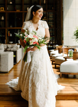 Load image into Gallery viewer, Watters 'Lyric 3012B' size 12 used wedding dress front view on bride