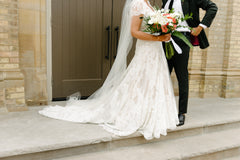 Watters 'Lyric 3012B' size 12 used wedding dress front view on bride