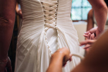 Load image into Gallery viewer, Custom 'Corset One Shoulder' size 8 used wedding dress back view on bride