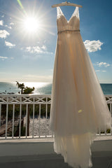 BHLDN 'Cassia' size 0 used wedding dress front view on hanger