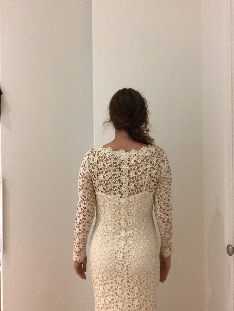 Severin 'Lace' size 4 used wedding dress back view on bride