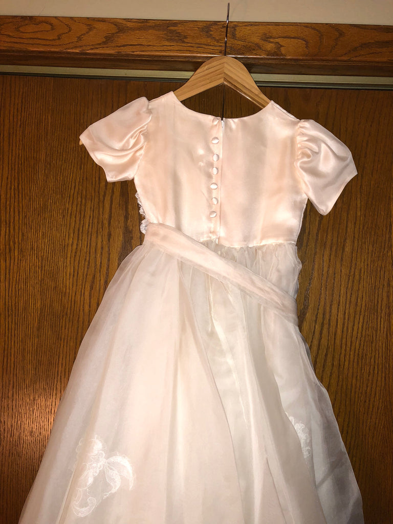 Exquisite Brides 'Dusty Pink and Ivory Layered Lace Appliquéd Flower Girl Dress-112' back view on hanger